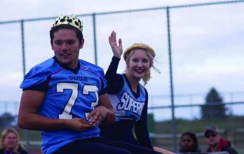 Seniors Brock Bergstrom and Claudia Androski ride through the parade as Homecoming King and Queen Sept. 27