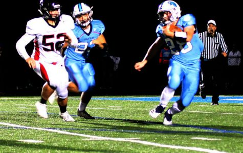 Junior Carter Fonger rushes with the football during Friday night's Homecoming game in a 36-14 victory over Chippewa Falls.