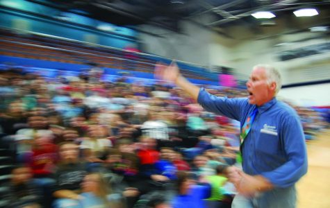 Assistant Principle Bill Punkyo gets students to do the wave at the 2019 Homecoming assembly Sept. 27.
