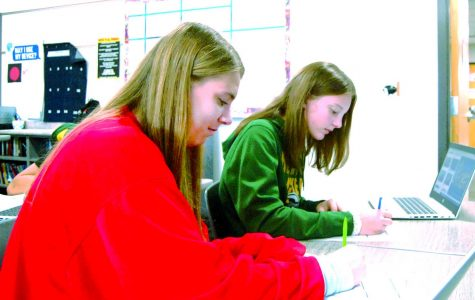 Freshman Katie Hughes (left) and freshman Charolette Johnson finish their schoolwork in the extra day of advisory on Sept. 29.