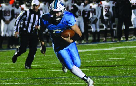 Senior Jarrett Gronski rushes for a touchdown during Superior's 44-37 victory over the Marshfield tigers Friday Oct.25 at the NBC Spartan Sports Complex. The Spartans will advance to the WIAA State Playoffs Level II.