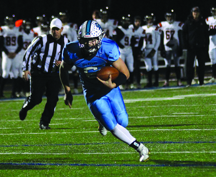 Senior+Jarrett+Gronski+rushes+for+a+touchdown+during+Superior%E2%80%99s+44-37+victory+over+the+Marshfield+tigers+Friday+Oct.25+at+the+NBC+Spartan+Sports+Complex.+The+Spartans+will+advance+to+the+WIAA+State+Playoffs+Level+II.+