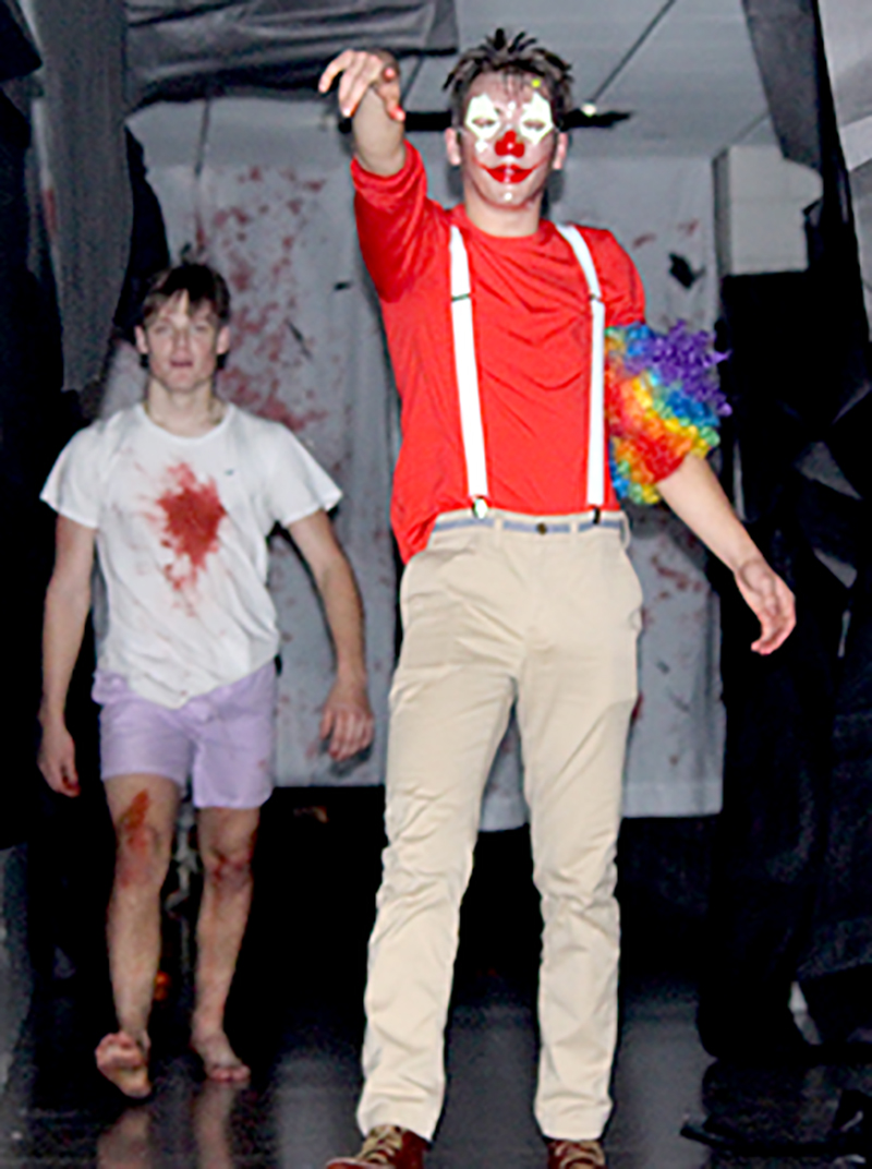 Seniors Gunnar Hansen and Noah Lear look on after scaring students out of the Haunted Hallway Wednesday night, Oct. 30.