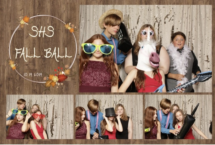 Clockwise from left, Freshman Leiani Polaski, Junior Raven Mickelson, Junior Cady Frye, Sophomore Noah Wells and Freshman Savannah Vig, ham it up for the camera in the photo booth area at Fall Ball at the Yellowjacket Union on the UWS campus the night of Oct. 19.