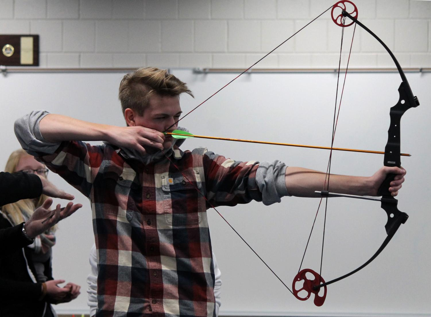 Senior Blaise Strom aims with his bow at archery practice Nov. 8. Strom has been shooting after he got into it from his love of the outdoors.