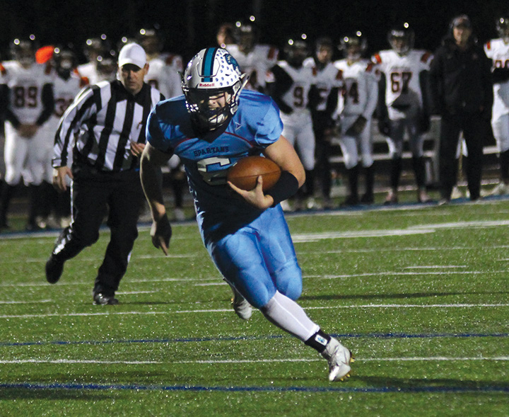 Senior+Jarrett+Gronski+rushes+towards+the+end+zone+in+Oct.+25+playoff+game+against+the+Marshfield+Tigers.+The+44-37+victory+in+this+game+sealed+the+Spartans+spot+in+the+WIAA+State+Playoffs+Level+II+game+against+Pulaski.