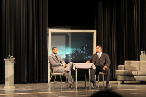 "(From left) Actor Julian Williams (Malcolm X) and Carl Crawford (Dr. Martin Luther King Jr.) sit across from each other at a table in their ""high rise apartment"", conversing about their daily lives and its issues during the play ""The Meeting""."