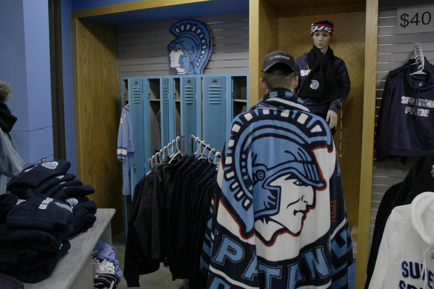 Senior Gunnar Hansen wraps up with the new Spartan blanket in the Spartan Shack Nov. 8.