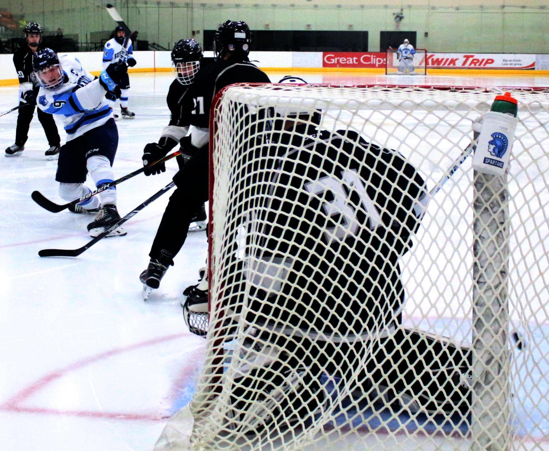 Senior Gunnar Hansen (9) follows through on a shot during his second-period goal. This is Hansen's sixth goal in six games on the season.
