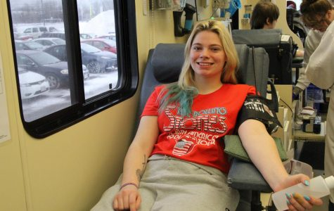 Senior Jessica Sundquist lays back on a cot inside the Memorial Blood Centers donation truck during her donation session on Dec. 13.