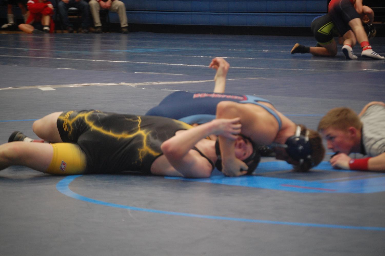 Spartan wrestler Caden Stone knocks down a Northwestern Tigers wrestler on Jan. 11 at the 37th annual Spartan classic