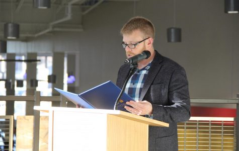 "Mayor Jim Paine stands at a podium on the second floor's main stairway at SHS on Feb. 24 to proclaim an official ""We Love Our Public Schools Week."" Mayor Paine's speech emphasizes the importance of education in Superior."
