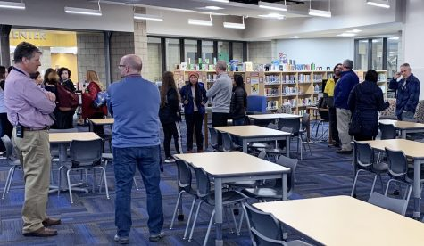Families and administrators discuss matters after a 5:30 p.m. meeting in the library March 11. Administrators announced the cancellation of the Spanish students' trip to Costa Rica just hours after the Coronavirus had been declared a pandemic by the World Health Organization.