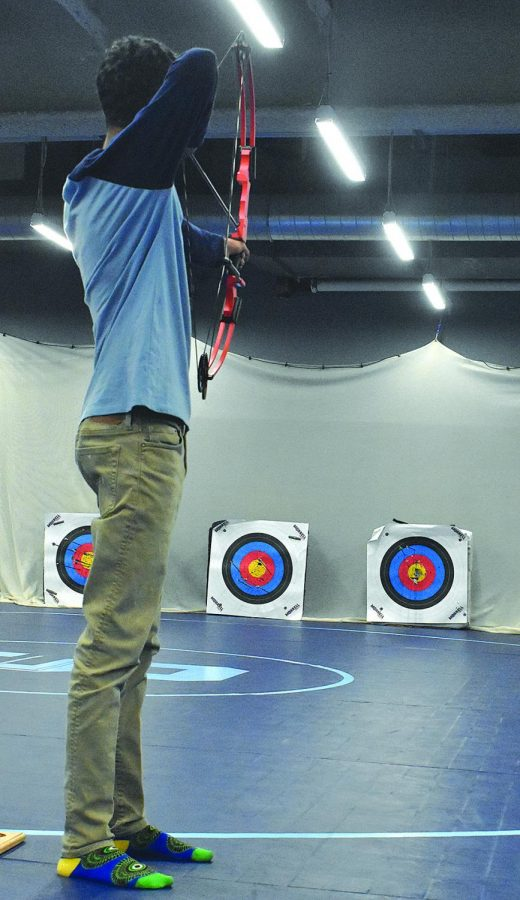 Freshman+Jorden+Hoffman+practices+for+archery+during+the+Half+Hour+Power+Hour+Feb.+14.++This+time+is+used+for+clubs+and+support+advisory%2C+a+lot+of+students+use+this+period+to+socialize+with+friends+in+the+commons.