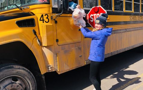Superior School District bus driver Heidi Lambert delivers a lunch to Jette Leopold, 5th grader at Great Lakes, on her route Monday morning, April 6.