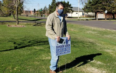 Principal Rick Flaherty places a sign in a Superior yard May, 6. The administration and teachers placed yard signs in seniors yards to show their appreciation and to try to help them celebrate while actual contact or gathering has been suspended for the remainder of the school year.