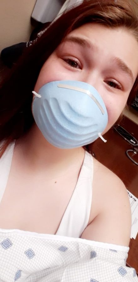 Sophomore+Kaydence+Young+in+mask+and+panic+minutes+before+her+COVID-19+test.+She+texted+this+photo+to+her+mom+before+being+escorted+into+testing.%0A