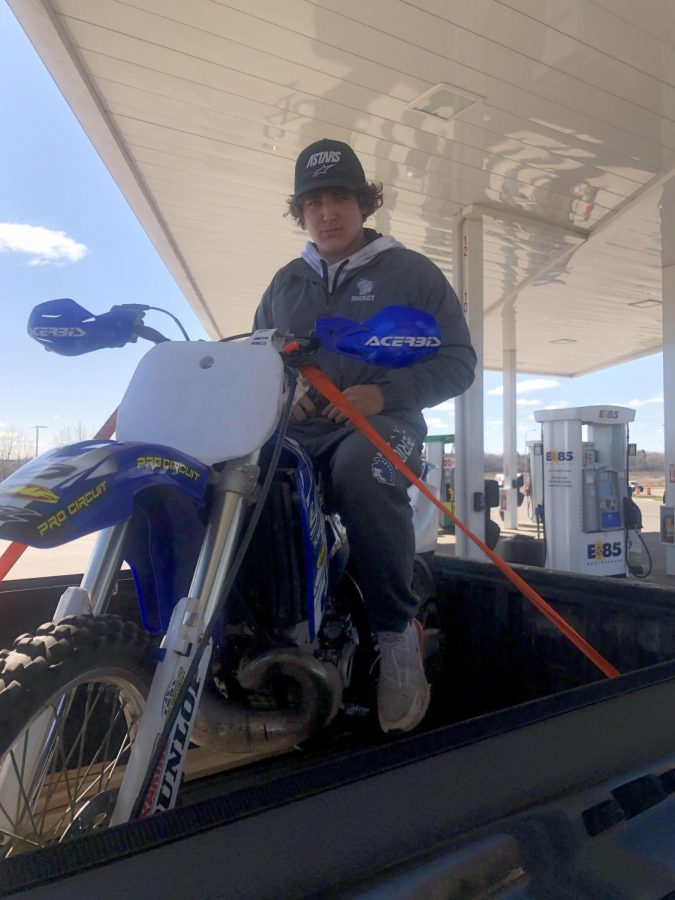+Sophomore+Austin+Ward+sits+on+his+Yamaha+Yz250+in+the+back+of+a+truck+May+8.+He+needed+to+gas+up+the+bike+in+city+limits%2C+but+the+law+does+not+allow+driving+it+in+the+city+limits.