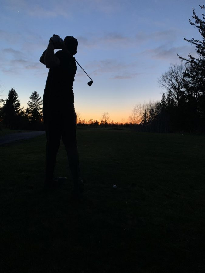 Junior+Matt+Nault+hits+a+golf+ball+on+North+9+at+Nemadji+Golf+Course+May.+13.+Nault+has+been+hitting+the+greens+every+day+the+course+has+been+open.