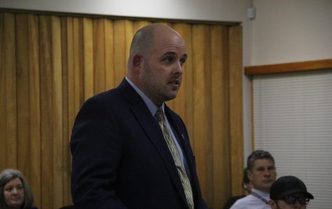 Senior Project advisor Rob Scott stands at the podium talking about changing the senior project guideline for future students at the Board meeting Feb. 4.
