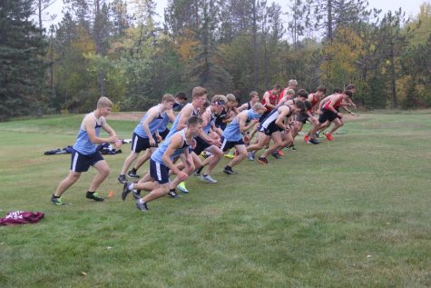 Boys top eight varsity runners take off at Lester Park Golf Course Sept. 24. Two of the varsity runners, Junior Noah Lawler  and Sophomore Jason Bruzek, are seen wearing gaiter masks, to prevent COVID-19 from spreading at the event.