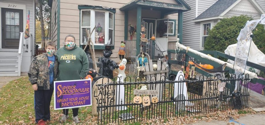 """Kelly Schoen and her son Braxton, standing next to their home at 2119 Ogden Avenue after they finished decorating for the """"Haunt Your House"""" competition."""