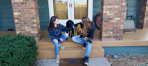 Traxx and his sister Rokkyn sit on their porch while they play one of their new songs Oct. 8. They played and sang respectively the chorus of popular 80's music.