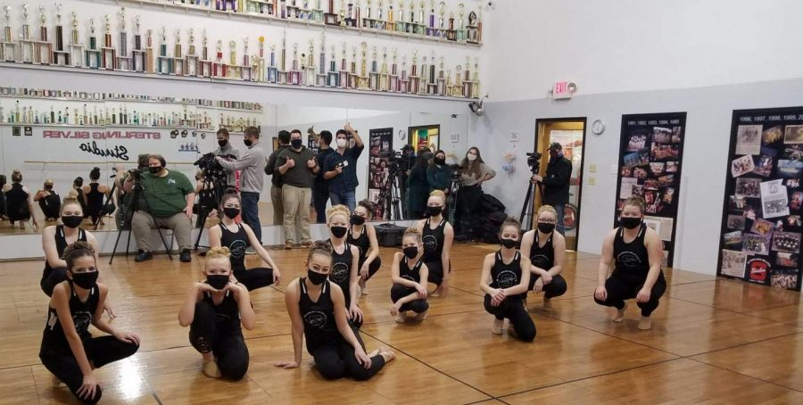 Students+from+Sterling+Silver+Studio+posing+with+the+KBJR+crew+after+they+record+their+performance+for+the+parade+on+Monday%2C+Nov.+16.