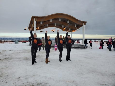 Fire twirlers from Sterling Silver Studio providing entertainment to festival goers on January 24, 2020.