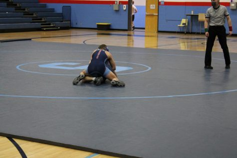 Sophomore Conner Krueger is winning against sophomore Caden Ostman on Tuesday Jan. 26 at the inner squad dual meet.