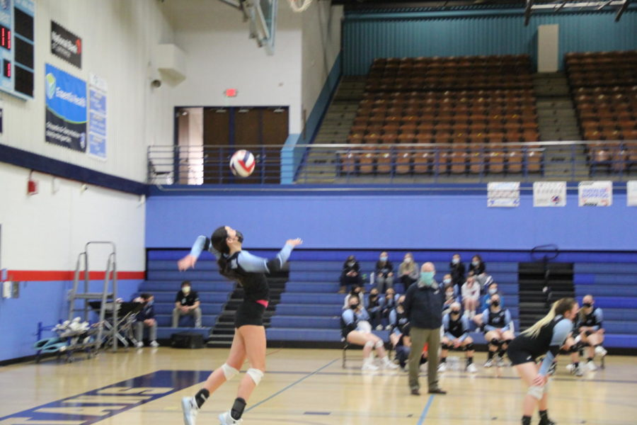 Junior Makayla McMeekin serves across the court to the Sparta Spartans on Thursday, March 4, at Spartan Arena.