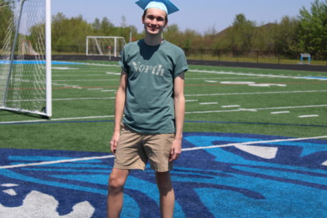 Senior, Commencement Speaker, Thomas Chicka stands on the football field where graduation will take place Saturday, June 5 at 1:00 p.m.