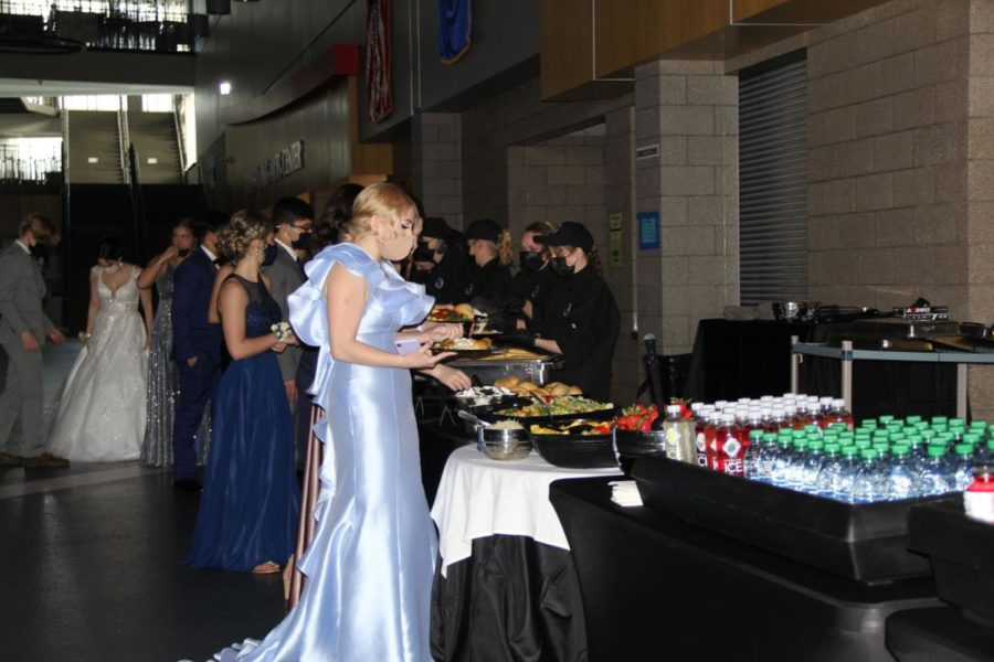 Students take part in the first ever dinner during Prom, with an array of different options for entrees and deserts.
