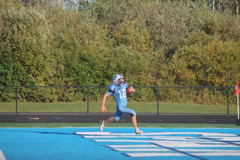 Junior Hayden Smith (12) scores a touchdown in the second quarter in a game against Eau Claire Memorial Sept. 27. Smiths touchdown was one of many scored by Superior in route to a victory over Eau Claire Memorial with the final score being 47-6.